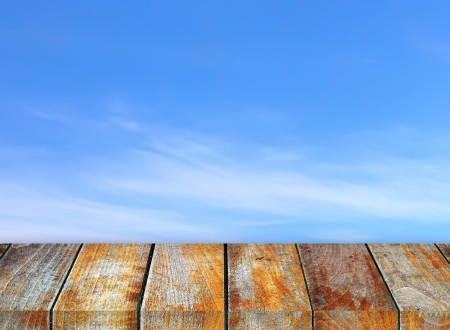 Wooden pier on sunny day with cloudy sky photo