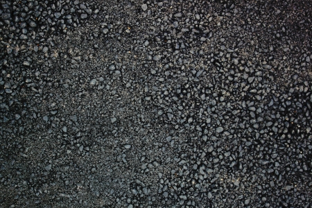 Pattern of the fresh grainy asphalt surface photo