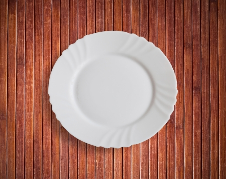 Plate on wooden plank background photo