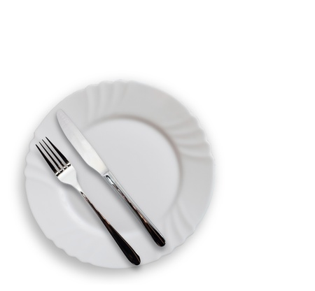 Plate with silverware on white background photo