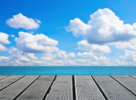 Wood walkway on sunny day near sea Stock Photo
