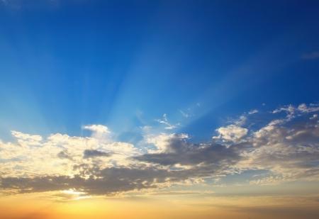 evening glow: Yellow blue sunset sky with sunlight