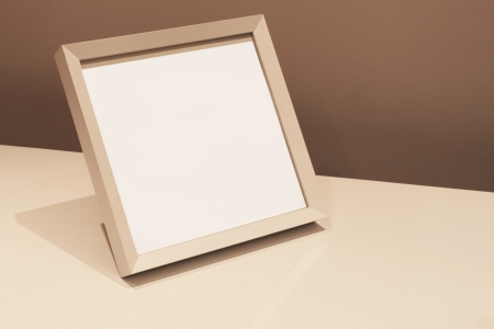 Blank photo frame on table Stock Photo - 17230122