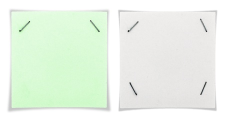 Green paper sheet sticked with paper clips photo