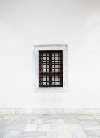 White wall with window and marble floor photo