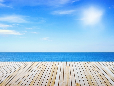 View to sunny sea from wooden pier photo