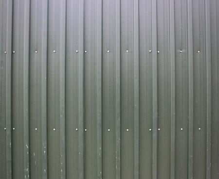 sheet metal: Striped metal sheet with screws