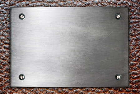 High detailed metal plate sign with screws on leather surface photo