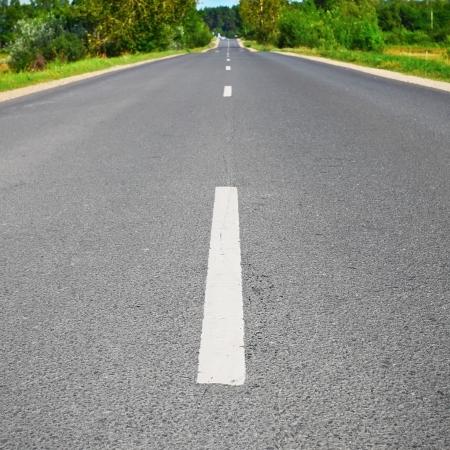 side road: Open asphalt road in field