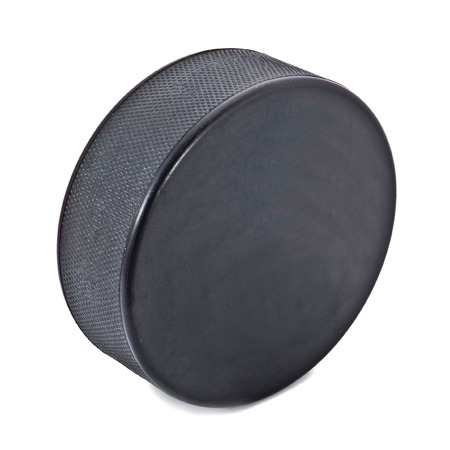 Ice hockey puck isolated on white Stock Photo