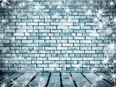 Wall from frozen bricks and wooden floor wth snowflakes photo