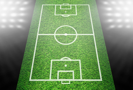 Green lined football field in spotlights photo
