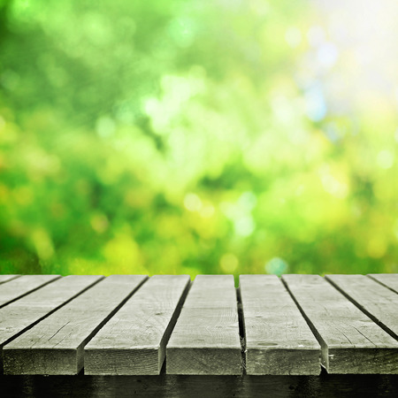 Wooden table near spring meadow