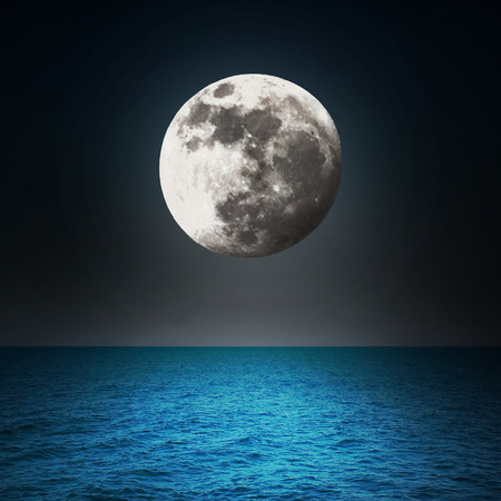 Moon in the night over the sea  photo