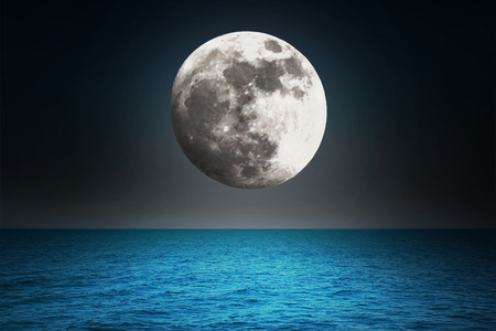 horizon over water: Moon in the night over the sea  Stock Photo