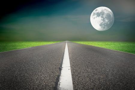 Moon light in the night green field photo