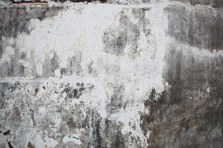 Old dark grunge wall on street photo