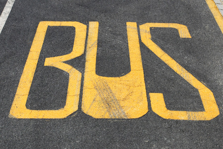 Bus stop staion write on the asphalt of road photo