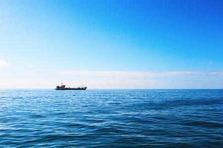 CArgo ship in ocean on sunny day