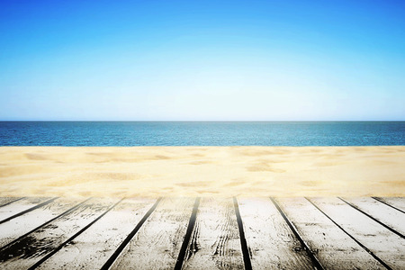 picnic table: Sandy beach on sunny summer day ith wooden walkway