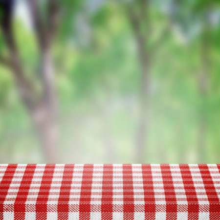 picnic table: Picnic table in tablecloth in park