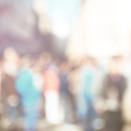 unrecognizable people: Crowd of unrecognizable people in sunny city Stock Photo