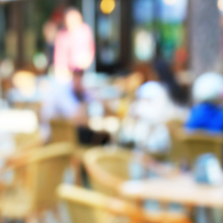unrecognizable people: Outside cafe on the open air, blurred background with bleached unrecognizable people Stock Photo