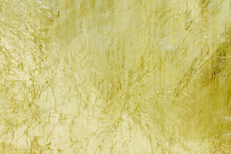 shiny background: Golden foil surface top view