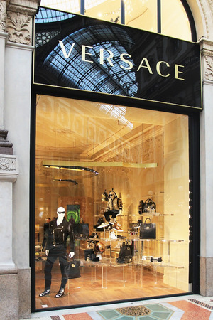 founded: MILAN,ITALY - APRIL 3, 2015: Versace boutique at Vittorio Emanuele II gallery in Milan. Versace is fashion brand that was founded in 1978. At the moment it has 500 employees.