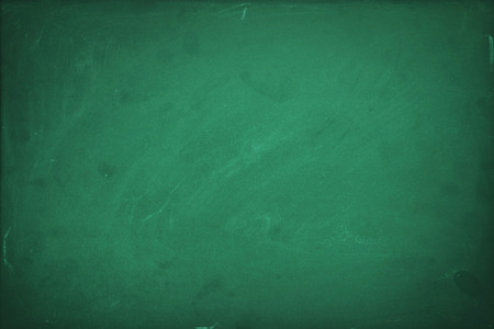 Empty green chalk board background Imagens