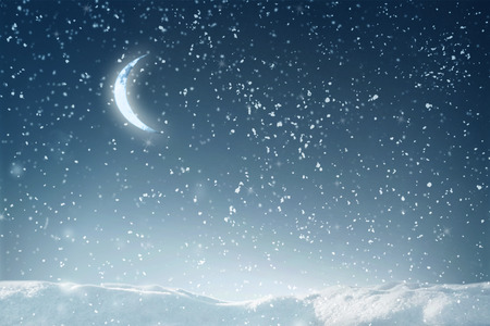 snow field: Winter flying snow in night over dark sky with moon and stars Stock Photo