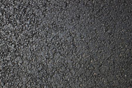 Dark fresh asphalt surface of the road