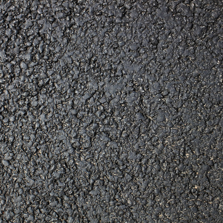 road surface: Dark fresh asphalt surface of the road