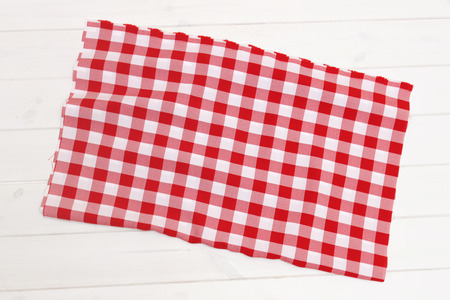 tablecloth: Big red tablecloth on blank wooden table surface Stock Photo