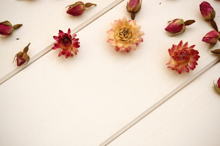 bourgeon: Dry roses on wooden background Stock Photo