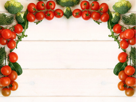 vegetables on white: White table of fresh tomatoes, top view