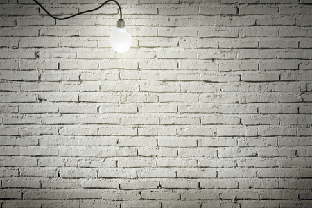 wall light: Industrial interior with wooden floor and brick white wall and bulb light on the roof