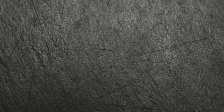dark grey slate: Black slate surface in scratches