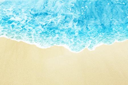 Brilliant color sea wave on the sunny sandy beach. Top view Reklamní fotografie