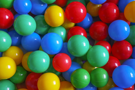 Colorful balls in the kids room as background