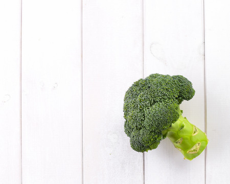 Ripe broccoli plant on white table
