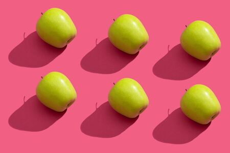 Green apple pattern on pink background