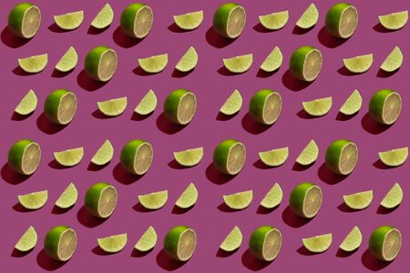 Pattern of the ripe lime cut parts on color background