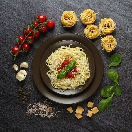 Prepared fresh pasta on a plate with ingredients Imagens