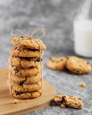 Stack of cookies with milk on the table Imagens