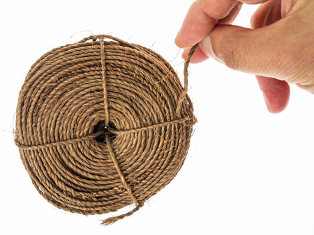 Ball of string and fingers clamp
