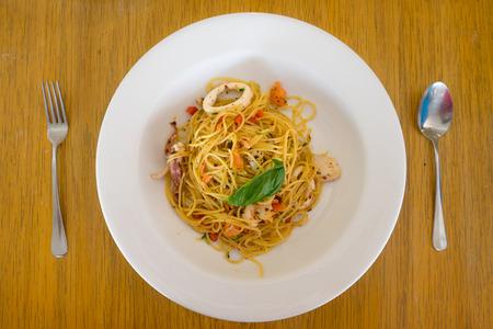 olio: Aglio Olio Pasta on a Wooden Table