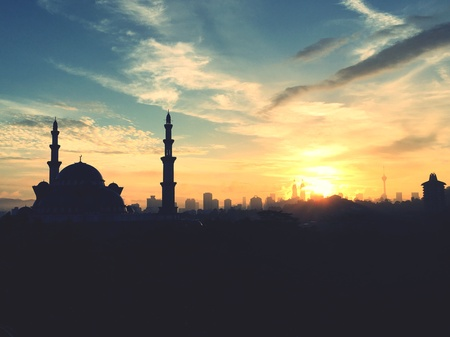 Sunrise with silhouette of kuala lumpur city skyline and federal mosque Stock Photo