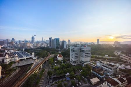 corporate buildings: Beautiful Sunrise at Kuala Lumpur city skyline, view from high rise building at dua sentral