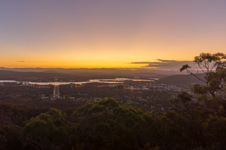 first australians: Beautiful sunset at Canberra city view from Mount Ainslie Lookout point.